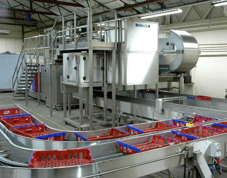 Basket feed conveyor